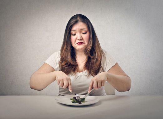 Sad Young Woman Eating Salad
