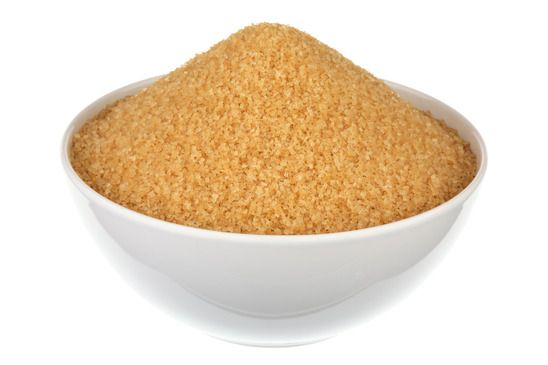 Brown Sugar In A Plate Over White Background